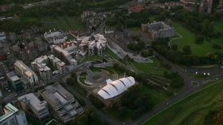 AX112_087 - 6K stock footage aerial video of the Dynamic Earth science center and Scottish Parliament, Scotland at sunset