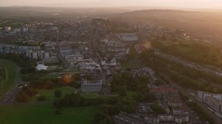 AX112_091 - 6K stock footage aerial video approach Scottish Parliament in Edinburgh, Scotland at sunset