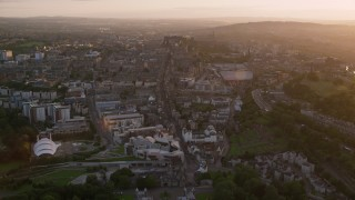 AX112_092 - 6K stock footage aerial video fly over Scottish Parliament toward Edinburgh Castle, Scotland at sunset