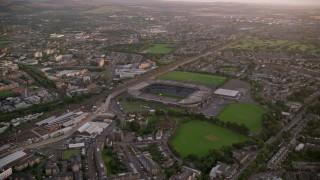 AX112_109 - 6K stock footage aerial video of approaching Murrayfield Stadium, Edinburgh, Scotland at Sunset