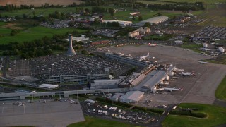 AX112_118 - 6K stock footage aerial video of terminals and control tower of Edinburgh Airport, Scotland at sunset