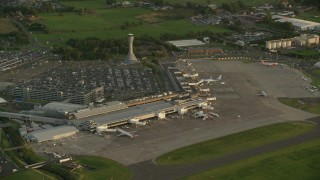 AX112_119 - 6K stock footage aerial video of orbiting Edinburgh Airport, Scotland at sunset