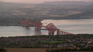 AX112_120 - 6K stock footage aerial video of Forth Bridge on Firth of Forth, Edinburgh, Scotland at sunset