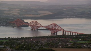 AX112_121 - 6K stock footage aerial video of Forth Bridge spanning Firth of Forth, Edinburgh, Scotland at sunset