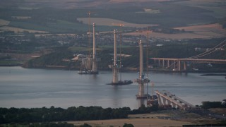 AX112_127 - 6K stock footage aerial video flyby bridge construction at sunset in Edinburgh, Scotland