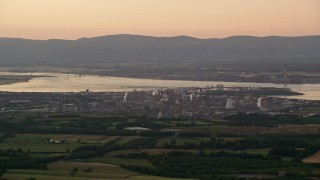 AX112_140 - 6K stock footage aerial video of a natural gas power plant, Falkirk, Scotland at sunset