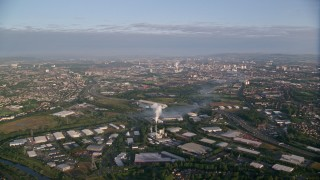 AX113_001 - 6K stock footage aerial video of warehouses, and cityscape of Glasgow, Scotland at sunrise