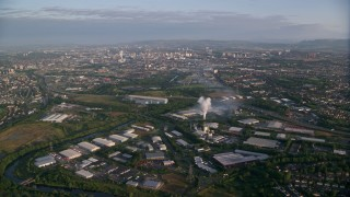 AX113_002 - 6K stock footage aerial video of flying by warehouses and  the cityscape of Glasgow, Scotland at sunrise