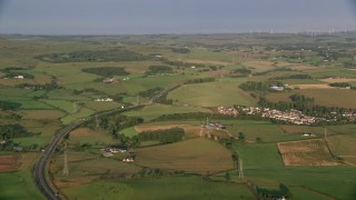 AX113_004 - 6K stock footage aerial video of farms, fields and rural homes, Glasgow, Scotland at sunrise