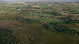 AX113_022 - 6K stock footage aerial video of vast farmland and fields, Kilmarnock, Scotland at sunrise