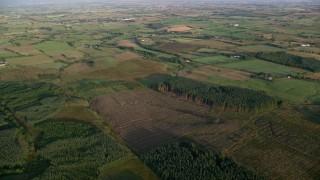 AX113_023 - 6K stock footage aerial video of farms and farming fields, Kilmarnock, Scotland at sunrise