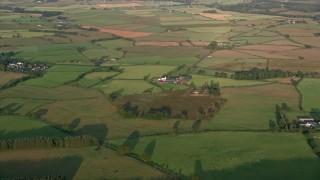 AX113_024 - 6K stock footage aerial video of farms and farmland, Kilmarnock, Scotland at sunrise