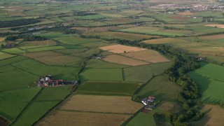 AX113_026 - 6K stock footage aerial video fly over fields and farms, Kilmarnock, Scotland at sunrise