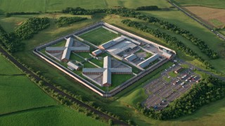 AX113_032 - 6K stock footage aerial video of orbiting Kilmarnock Prison, Scotland at sunrise