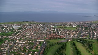 AX113_035 - 6K stock footage aerial video of neighborhoods near Firth of Clyde, Prestwick, Scotland