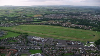 AX113_037 - 6K stock footage aerial video of orbiting the Ayr Racecourse, Scotland