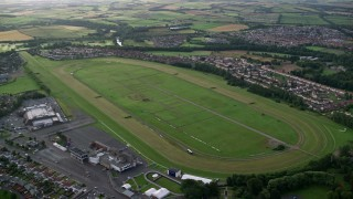 AX113_038 - 6K stock footage aerial video of an orbit of the Ayr Racecourse, Scotland