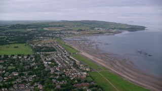 AX113_039 - 6K stock footage aerial video approach beachfront homes along Firth of Clyde, Ayr, Scotland