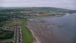 AX113_040 - 6K stock footage aerial video fly over beachfront homes near Firth of Clyde in Ayr, Scotland