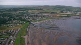AX113_041 - 6K stock footage aerial video approach beachfront homes along Firth of Clyde, Ayr, Scotland