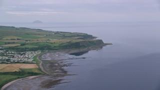 AX113_042 - 6K stock footage aerial video approach coastal cliffs on Firth of Clyde, Ayr, Scotland