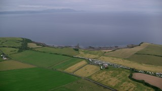 AX113_046 - 6K stock footage aerial video of farms and fields on the coast of the Firth of Clyde, Ayr, Scotland