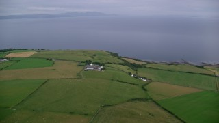 AX113_047 - 6K stock footage aerial video of farming fields along the coast of the Firth of Clyde, Ayr, Scotland