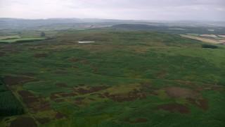 AX113_049 - 6K stock footage aerial video of moorland and Drumshang Loch, Ayr, Scotland