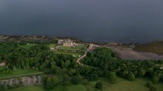 AX113_056 - 6K stock footage aerial video of orbiting Culzean Castle by Firth of Clyde, Maybole, Scotland