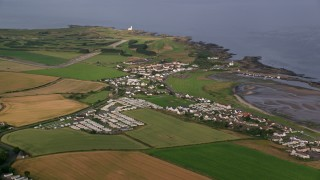 AX113_057 - 6K stock footage aerial video of a coastal village and RV park along Firth of Clyde, Maidens, Scotland