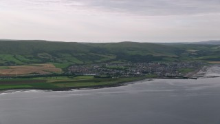 AX113_067 - 6K stock footage aerial video of the coastal town by the Firth of Clyde, Girvan, Scotland