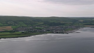 AX113_068 - 6K stock footage aerial video of passing the coastal town of Girvan beside the Firth of Clyde, Scotland