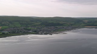 AX113_069 - 6K stock footage aerial video of the coastal town of Girvan by the Firth of Clyde, Scotland