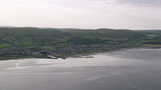 AX113_070 - 6K stock footage aerial video flyby the coastal town of Girvan by Firth of Clyde, Scotland