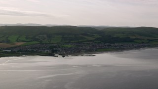 AX113_071 - 6K stock footage aerial video of a view of the coastal town of Girvan by the Firth of Clyde, Scotland