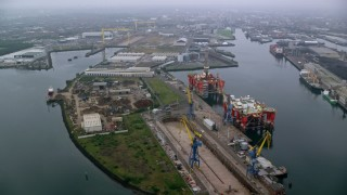 AX113_079 - 6K stock footage aerial video of flying over docks at the Port of Belfast, Northern Ireland