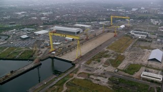 AX113_081 - 6K stock footage aerial video of construction cranes in the harbor at Port of Belfast, Northern Ireland