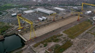 AX113_082 - 6K stock footage aerial video of orbiting cranes at the Port of Belfast, Northern Ireland