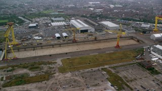 AX113_084 - 6K stock footage aerial video of construction cranes at the Port of Belfast, Northern Ireland