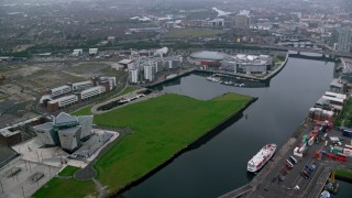 AX113_085 - 6K stock footage aerial video of Odyssey Arena and Titanic Museum on the River Lagan, Belfast, Northern Ireland