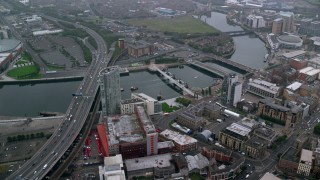 AX113_089 - 6K stock footage aerial video of bridges and office buildings along River Lagan, Belfast, Northern Ireland