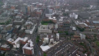 AX113_091 - 6K stock footage aerial video orbit city streets and office buildings, Belfast, Northern Ireland