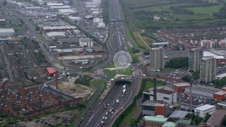 AX113_093 - 6K stock footage aerial video of the Rise sculpture and M1 Freeway near office buildings, Belfast, Northern Ireland