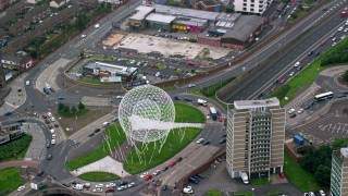 AX113_095 - 6K stock footage aerial video passing the Rise sculpture and M1 Freeway, Belfast, Northern Ireland Day
