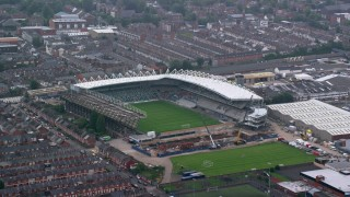 AX113_096 - 6K stock footage aerial video of orbiting Windsor Park soccer stadium, Belfast, Northern Ireland
