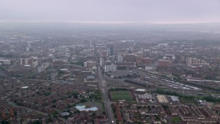 AX113_100 - 6K stock footage aerial video follow Grosvenor Road toward office buildings, Belfast, Northern Ireland