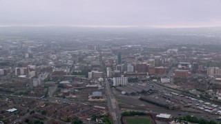 AX113_101 - 6K stock footage aerial video approach office buildings and cityscape of Belfast, Northern Ireland