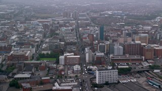 AX113_102 - 6K stock footage aerial video follow Grosvenor Road through the city of Belfast, Northern Ireland