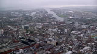 AX113_104 - 6K stock footage aerial video of Port of Belfast seen from the city, Northern Ireland