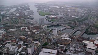 AX113_105 - 6K stock footage aerial video of Port of Belfast and River Lagan bridges, Northern Ireland